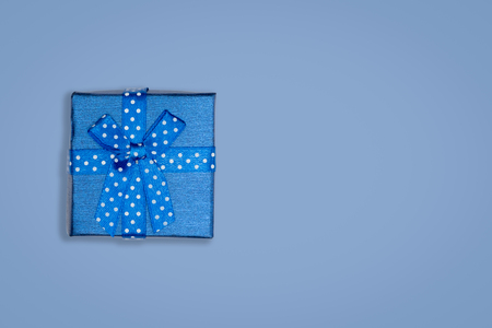 Top view of blue gift box on bluebackground. with copy space for text.
