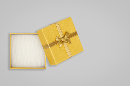 Top view of opened yellow gift box on glay background. with copy space for text.