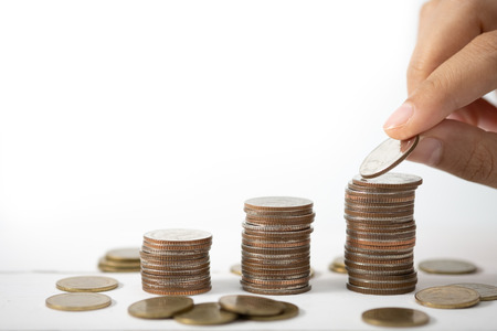 Hand stack coins,  concept for Saving money, growing business and wealthy.