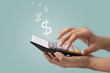 Hand using a calculator to calculate the dollar, Idea concept. Stock Photo