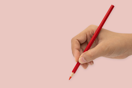Female hand with colorful pencil isolated on white background. Minimal concept. Stock Photo