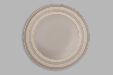 Top view-Empty brown ceramic round dish plate isolated on grey background. Reklamní fotografie