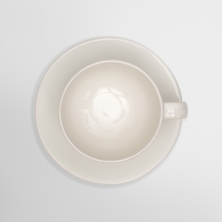 Top view-close up of a white cup on white background. Reklamní fotografie