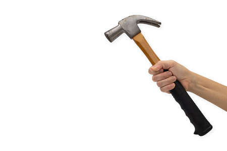 Womans hand holding hammer isolated on white background.
