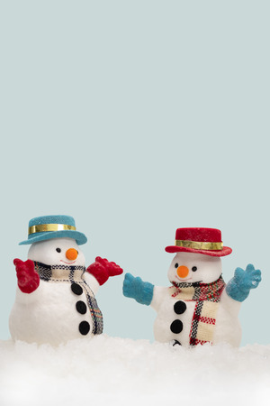 Two snowman on blue background with copy space for season greeting Merry Christmas, AF point selection, Reklamní fotografie