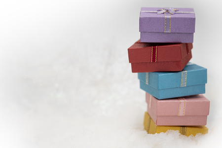 gift boxes on the white ice snow with copy space for season greeting Merry Christmas or Happy New Year.