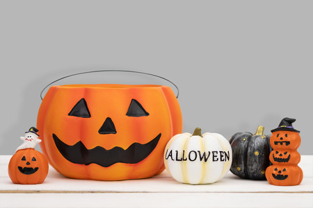 Halloween pumpkin on grey background. Halloween idea concept.