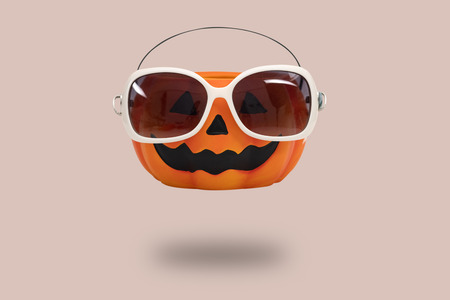 Halloween pumpkin with glasses on pink background. Halloween minimal idea concept. Reklamní fotografie