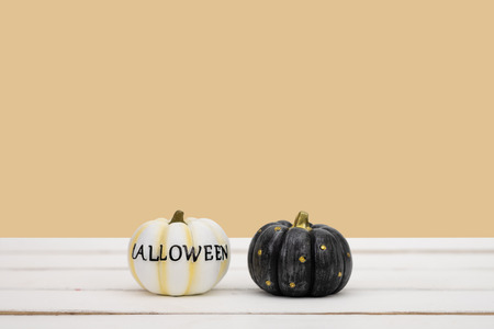 Halloween pumpkin on yellow background. Halloween idea minimal concept. Reklamní fotografie