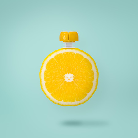 Orange juice and straw on blue pastel background, Refreshing concept and minimal style.