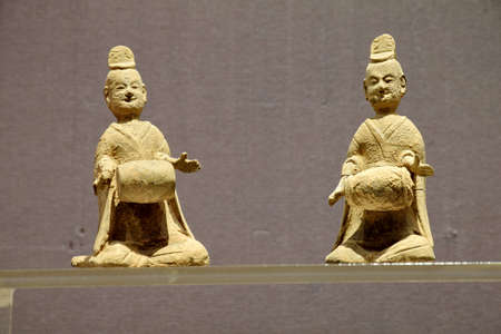 drumming: Pottery figurines drumming Northern