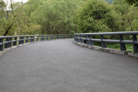 guardrail: Concrete walkway with fence