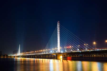 xing: Qianjiangsanqiao XI XING bridge at night Editorial