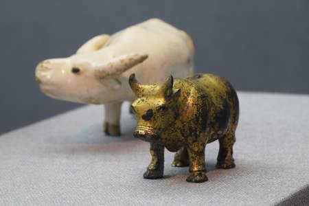 cultural artifacts: White porcelain Niu Heliu golden calf