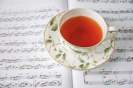 sheet music: tea on music sheet Editorial