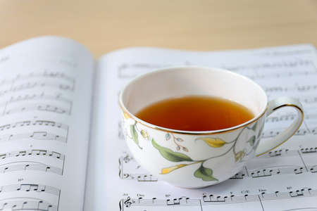 sheet music: tea on music sheet Stock Photo
