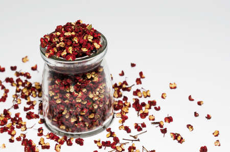 peppercorns: peppercorns in a glass container Stock Photo