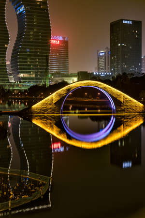stone arch: stone arch bridge at night view Editorial