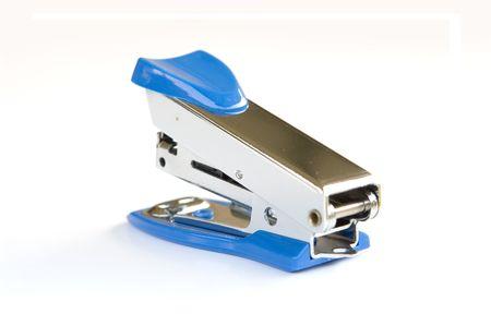 Blue stapler on white background photo