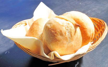 bread in basket - little roll breads in basket on table Stock Photo - 5529962