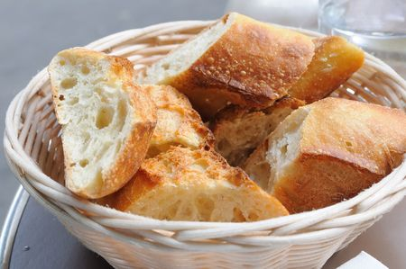 bread in basket - little roll breads in basket on table Stock Photo - 5555351