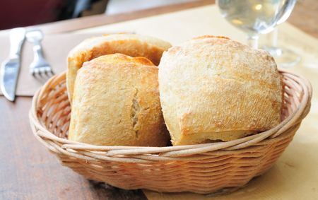 bread in basket - little roll breads in basket on table Stock Photo - 5600499