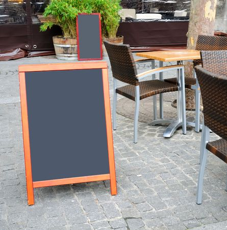 Paris street view of a Restaurants terrace with blackboard photo