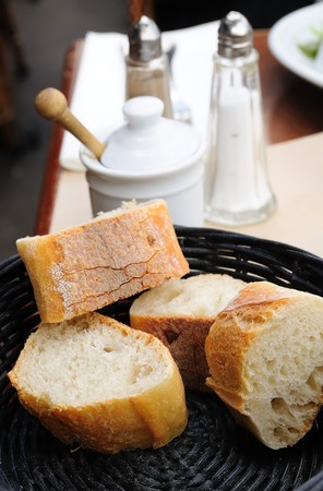 little roll breads in basket on table Stock Photo - 7614810