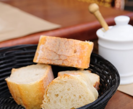 little roll breads in basket on table Stock Photo - 7614776
