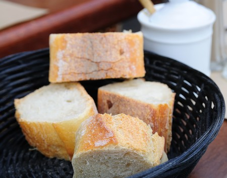 little roll breads in basket on table Stock Photo - 7629233