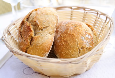 little roll breads in basket on table Stock Photo - 7629254