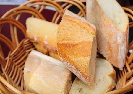 little roll breads in basket on table Stock Photo - 7629266