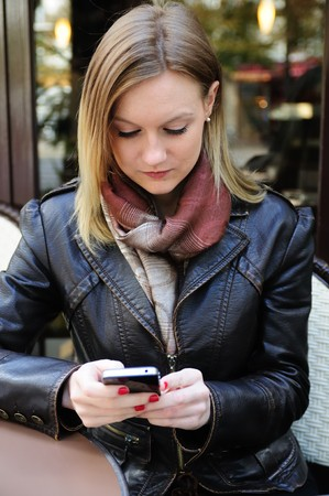 Female Outdoor Cafe Portrait with cellular telephone Stock Photo - 7877925