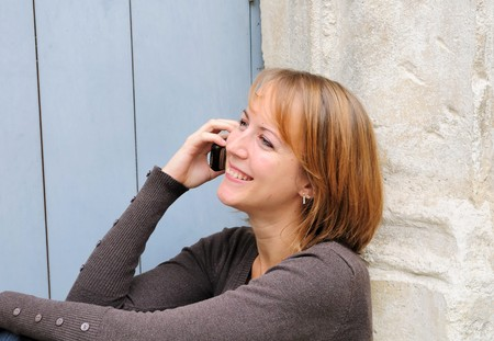 gentle: Outdoor portrait young woman talk on a cellular telephone  Stock Photo