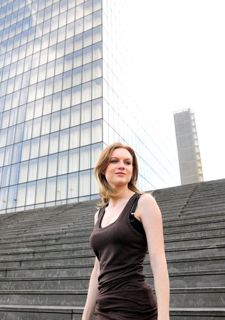 citylife: Outdoor portrait young woman with modern building