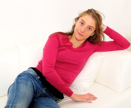 beautiful young woman on the couch in the livingroom Stock Photo - 8263764