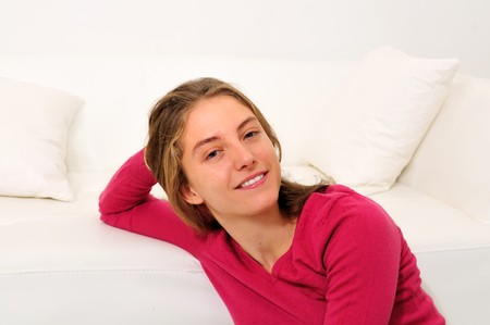 beautiful young woman on the couch in the livingroom Stock Photo - 8263755