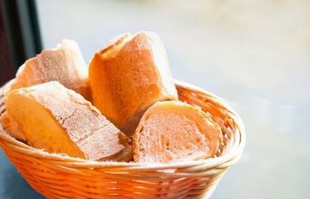 bread in basket - little roll breads in basket on table Stock Photo - 8575250
