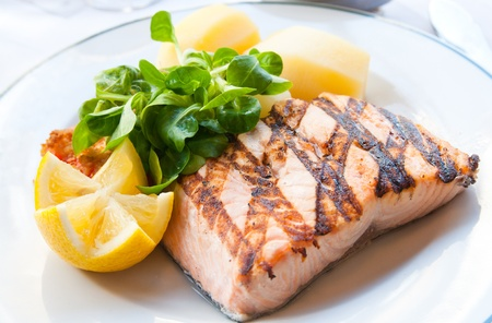 grilled salmon: grilled salmon with sauce,lemon and tomato