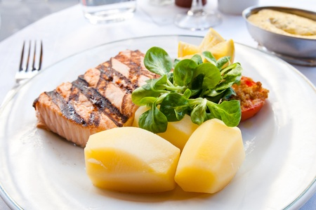grilled salmon with sauce,lemon and tomato Stock Photo - 9003393