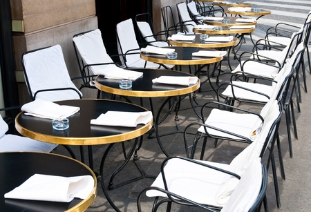 Street view of a Cafe terrace with empty tables and chairs photo