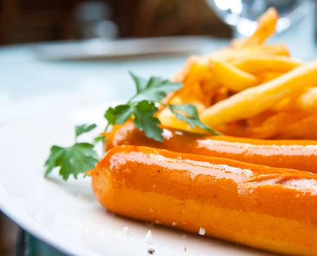 Grilled sausage served with french fries photo