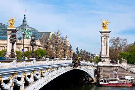 Pont Alexandre III is an arch bridge that spans the Seine, widely regarded as the most ornate, extravagant bridge in Paris. photo