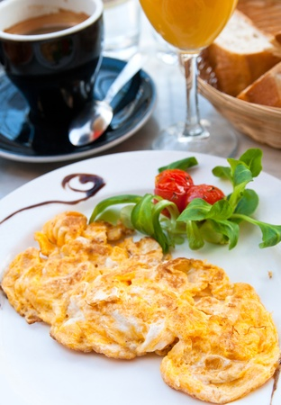 omelet and green salad with orange juice ,Delicious!   photo