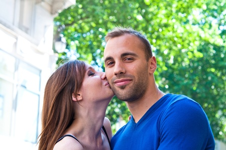 Happy Portrait of Young kissing couple in the streets of Paris Stock Photo - 9620932