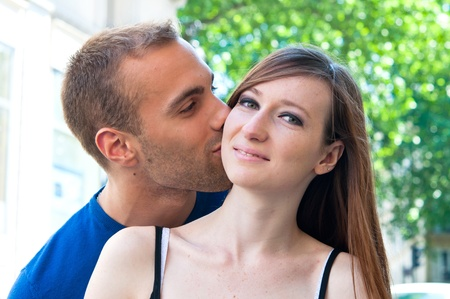 Happy Portrait of Young kissing couple in the streets of Paris Stock Photo - 9620920