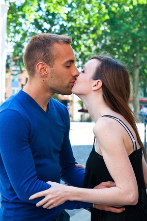 Happy Portrait of Young kissing couple in the streets of Paris photo
