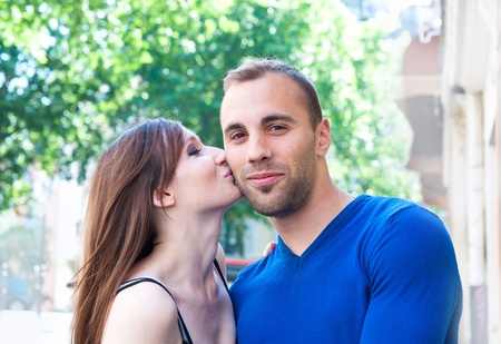 Happy Portrait of Young kissing couple in the streets of Paris Stock Photo - 9661799
