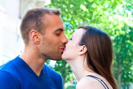 Happy Portrait of Young kissing couple in summer green garden Stock Photo - 9661863