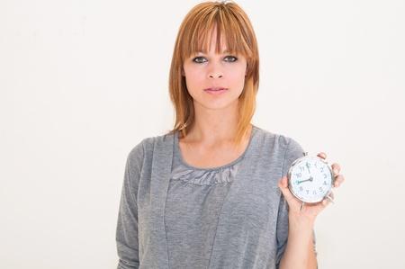 beautiful young woman holding alarm clock Stock Photo - 9661739